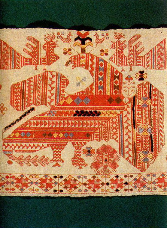 Eagle enframed by solar symbols and plant motifs on coverlet edges. <br/>Second half of   19th century