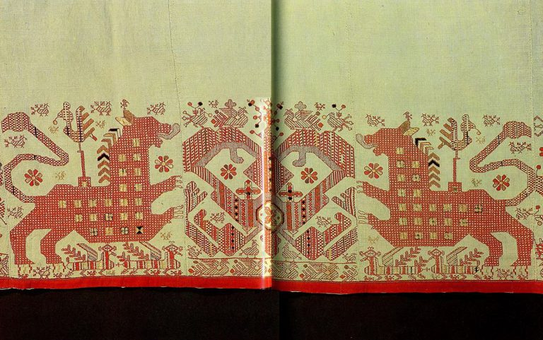 """Sun chariot"" (detail) with lions enframed by birds on the bodice of a Kargapol  woman's shirt"