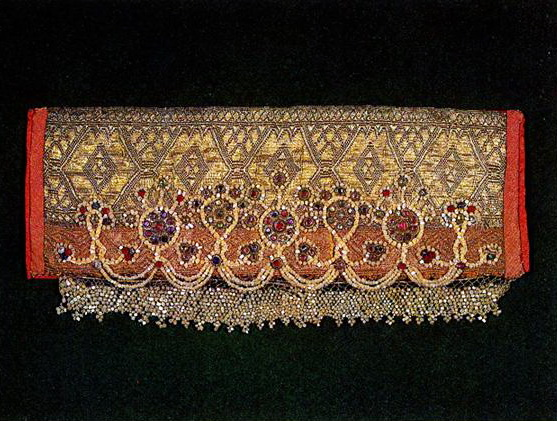 Central Russia headdress with stylized half-figures of women and plant motifs. <br/>Second half of 19th century