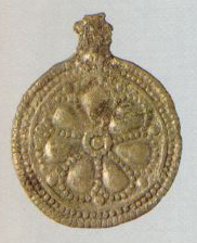 Pendant with the image of a seven-petal flower. 1st half of the 13th century