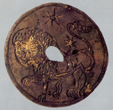 Round gilt plaque depicting the figure of a lion. <br/>Late 12th century