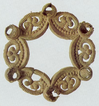 Openworked fibula with six sockets for inserts. <br/>Second half of the 12th century