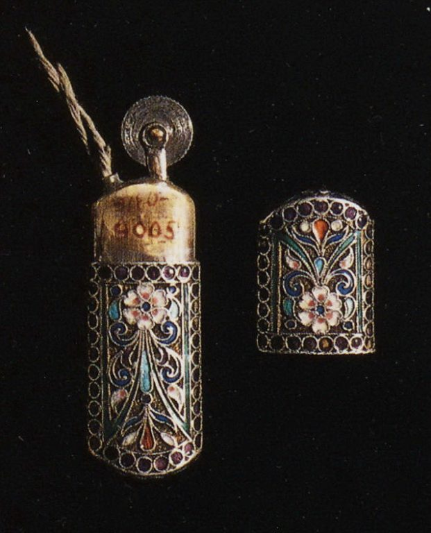Selection of silver-gilt object with enamel and filigree decoration: A cigar lighter. 1880th