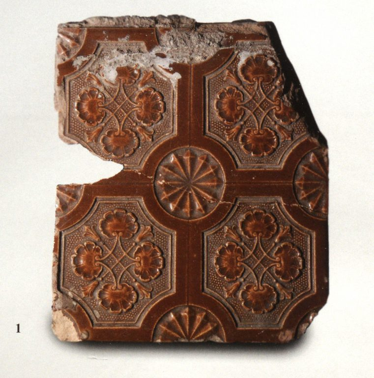 Monochrome wall tiles with floral relief ornament. <br/>Late 19th century - early 20th century