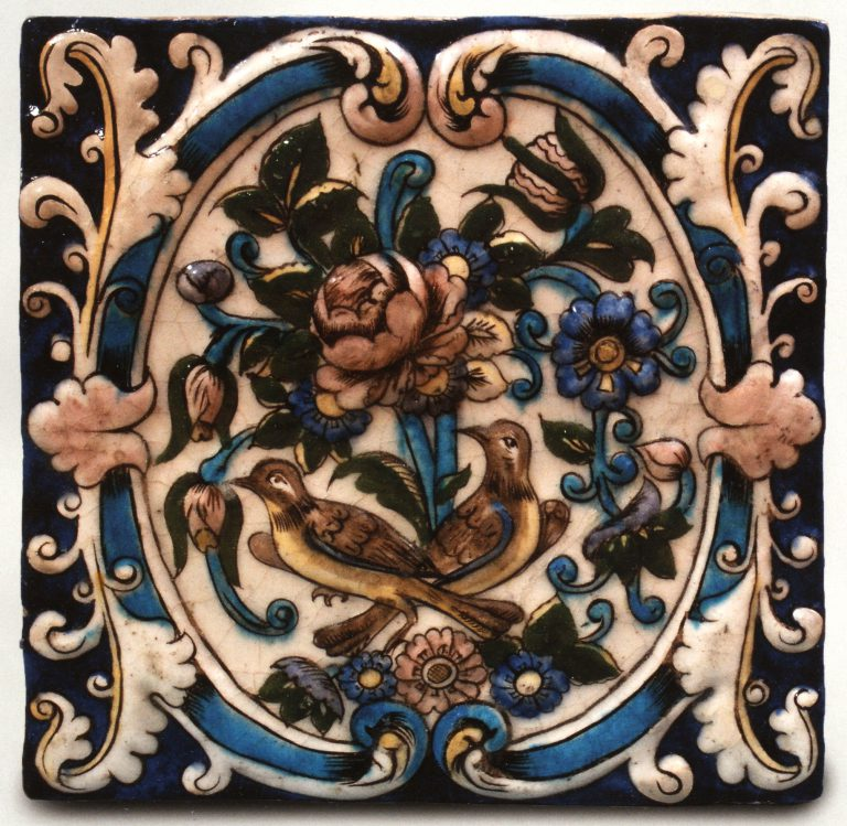Decorative ceramic tiles. Multicoloured relief ornament with plants and animals. Late 19th century - early 20th century
