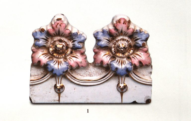 Tiles with painted relief ornament and gilding. Early 20th century