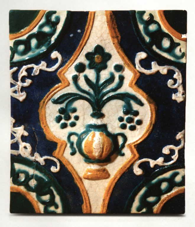 "Multicoloured relief wall tile. Plant ornament (""bouquet in a vase"" motif). <br/>First half of 18th century"