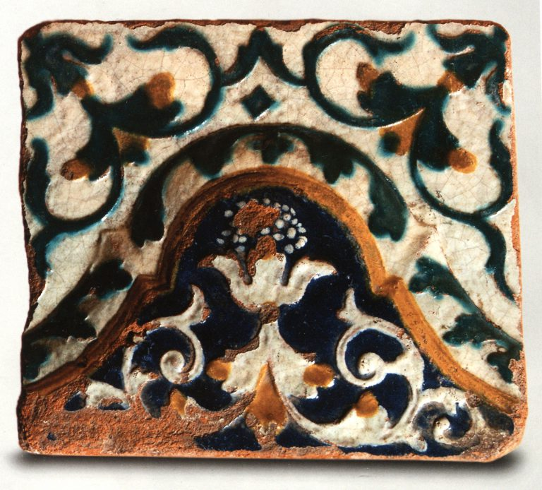 Multicoloured wall tile with floral relief ornament. First half of 18th century