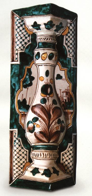 Multicoloured corner tile. Floral and genre ornament. <br/>Second half of 18th century