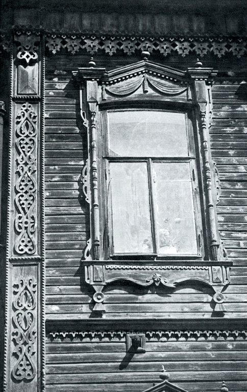 Window and decorated corner of a house. <br/>Late 19th century - early 20th century