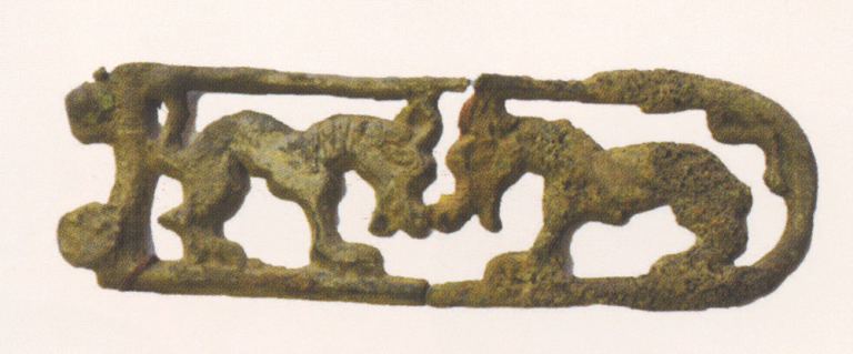 Bronze tip of the knife with the image of a bird of prey. <br/>1st century AD