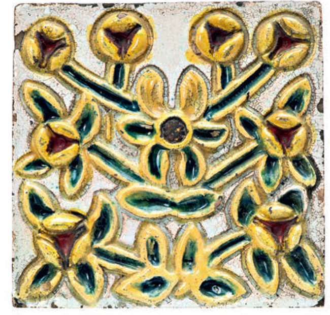 Stove tile with embossed image of yellow stylized flowers. <br/>Around 1900 year