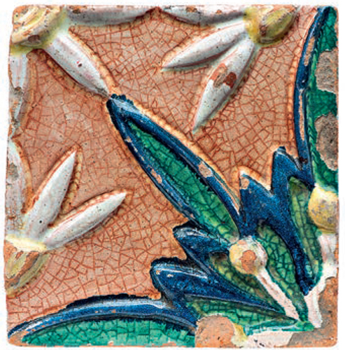 Tile with a relief floral polychrome ornament. Part of the composition. <br/>Еarly 20th century