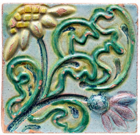 Tile with a relief polychrome image of daisies. 1890 years