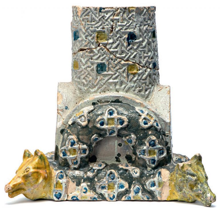 Base and part of a relief polychrome column with sculptured wolf heads. <br/>Late 19th — early 20th century