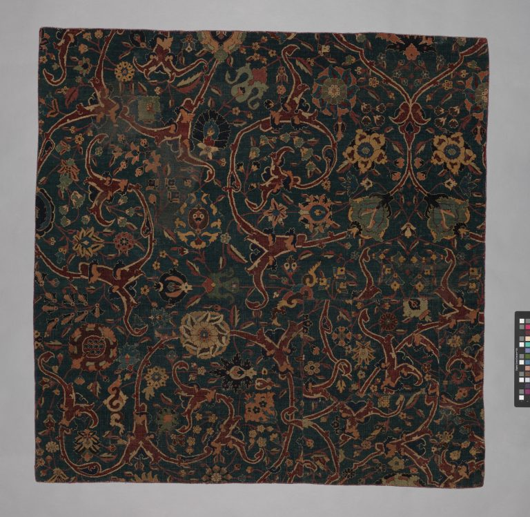 Blue-ground Carpet Fragment with Scrolling Floral Vines. <br/>17th century